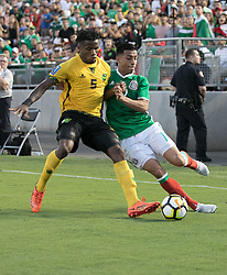 July 23, 2017 - Pasadena, California, U.S - Angel Sepulveda #19 of Mexico and Alvas Powell #5 of Jamaica battle for the ball during their Gold Cup Semifinal game at the Rose Bowl in Pasadena, California on Sunday July 23, 2017. Jamaica defeats Mexico, 1-0. (Credit Image: © Prensa Internacional via ZUMA Wire)