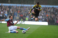 Chelsea's Eden Hazard hurdles over the sliding tackle from Villa's Ron Vlaar.  Barclays Premier League, Aston Villa v Chelsea at Villa Park in Birmingham on Saturday 11th May 2013. pic by Andrew Orchard,  Andrew Orchard sports photography,