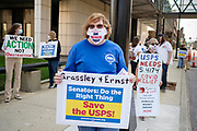 25 AUGUST 2020 - DES MOINES, IOWA: People picket the Neal Smith Federal Building in Des Moines. About 100 people, postal workers and members of the public, came to the Neal Smith Federal Building Tuesday to call for increased spending for the US Postal Service and an end to attacks on the USPS by members of the Trump administration. The rally was a part of a series national rallies organized by the American Postal Workers Union (APWU). Many of the people at the rally expressed concerns that the President's actions versus the USPS could harm their ability vote by mail in the November general election.     PHOTO BY JACK KURTZ