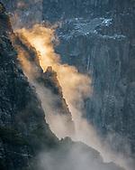 Sunlit morning mist along cliff face in Yosemite Valley, Yosemite National Park, California