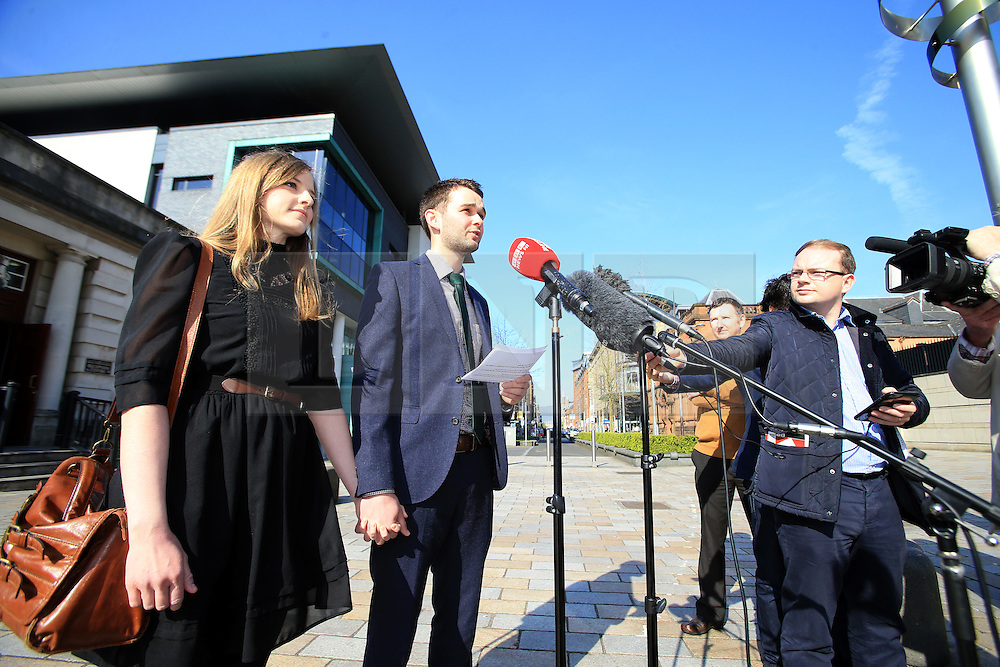 """© Licensed to London News Pictures. 9/05/2016. Belfast, Northern Ireland, UK. Daniel McArthur with Amy speak to the media before entering at Belfast High Court for the start Appeal hearing over gay marriage cake row with Ashers Baking Company. The legal appeal by Ashers Baking Company in the controversial 'gay cake' case is to be heard over two days. In May last year a judge at Belfast County Court ruled that the bakery had acted unlawfully. The court ordered Ashers to pay £500 damages after Judge Isobel Brownlie said the customer had been treated """"less favourably"""" contrary to the law and the bakery had breached political and sexual orientation discrimination regulations. But the McArthur family who own and run Ashers decided to challenge the ruling following consultations with their legal advisors. The family has been given the full support of The Christian Institute, which has funded their defence costs. The legal case followed a decision in May 2014 by Ashers to decline an order placed at its Belfast store by a gay rights activist who asked for a cake featuring the Sesame Street puppets, Bert and Ernie, and the campaign slogan, 'Support Gay Marriage'. The customer also wanted the cake to feature the logo of a Belfast-based campaign group QueerSpace. Ashers, owned by Colin and Karen McArthur, refused to make the cake because it carried a message contrary to the family's firmly-held Christian beliefs. They were supported by their son Daniel, the General Manager of the company. But the Equality Commission for Northern Ireland (ECNI) launched a civil action against the family-run bakery, claiming its actions violated equality laws in Northern Ireland and alleging discrimination under two anti-discrimination statutes – The Equality Act (Sexual Orientation) Regulations (NI) 2006 and The Fair Employment and Treatment (NI) Order 1998. Photo credit : Paul McErlane/LNP"""