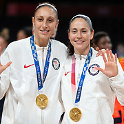 TOKYO, JAPAN August 8:  Five-time Olympic gold medalists Diana Taurasi, (left) and Sue Bird of the United States with their gold medals after the team victory during the Japan V USA basketball final for women at the Saitama Super Arena during the Tokyo 2020 Summer Olympic Games on August 8, 2021 in Tokyo, Japan. (Photo by Tim Clayton/Corbis via Getty Images)