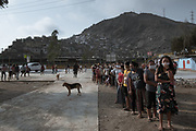 A queue of indigenous women waiting for food supplies as part of government donations during the isolation mandatory period to prevent the COVID-19 to spread. Unfortunately they only received chopped and frozen carrots brought from South Korea.