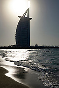 Black and White photo of the Burj Al Arab Hotel (Tower of the Arabs) in the Persian Gulf. The shape of the structure is designed to resemble the sail of a ship. It is one of the tallest hotels in the world,