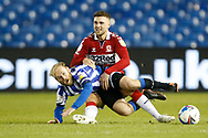 Middlesbrough midfielder Lewis Wing (8) is fouled by Barry Bannan of Sheffield Wednesday  during the EFL Sky Bet Championship match between Sheffield Wednesday and Middlesbrough at Hillsborough, Sheffield, England on 29 December 2020.