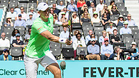 Tennis - 2019 Queen's Club Fever-Tree Championships - Day One, Monday<br /> <br /> Men's Singles, First Round: Cameron Norrie (GBR) Vs. Kevin Anderson (RSA)  <br /> <br /> The tennis ball completely flattens on the racquet of Kevin Anderson (RSA) as he blocks the drive from Cameron Norrie (GBR) on Centre Court.<br />  <br /> COLORSPORT/DANIEL BEARHAM