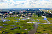 Nederland, Noord-Holland, Zaanstad, 14-06-2012; Guisveld, onderdeel van de Westzanerpolder (Polder Westzaan). Het Natura 2000 gebied ligt ingeklemd tussen de bebouwing van Zaanstad die steeds verder oprukt. Op het tweede plan nieuwbouw van Zaandijk (Rooswijk), Zaandam aan de horizon. .Nature reserve wedged between the advancing urban development, houses and buildings..luchtfoto (toeslag), aerial photo (additional fee required).foto/photo Siebe Swart