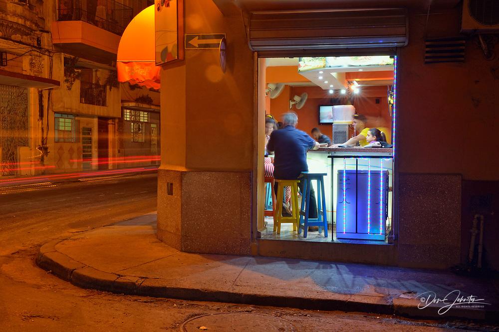 Street photography in central Havana- Open bar at night on Calle Neptuno, La Habana (Havana), Habana, Cuba
