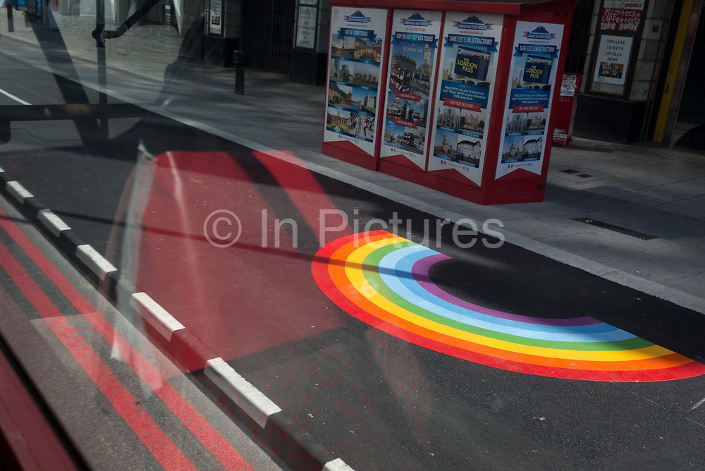 With a further 184 reported UK Covid deaths in the last 24 hrs, a total now of 43,414, seen from a London bus is an NHS supporting rainbow is at a Victoria Station bus stop, a part of the social distance policy of widening pavements for pedestrians, on 26th June 2020, in London, England. Government restrictions on the 2 metre rule is to be relaxed on 4th July and replaced with one metre plus in the hope it stimulates the struggling UK economy.