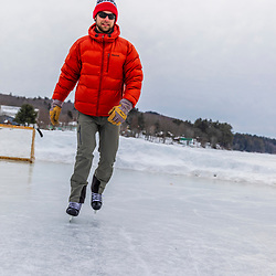 A man ice skating on Long Lake in Harrison, Maine.