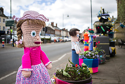 © Licensed to London News Pictures. 27/04/2016. Thirsk UK. Picture shows the Bollards in Thirsk that have been Yarn Bombed. Under the cover of Darkness 300 Yarn bombing street artist's have covered the Town centre of Thirsk, the group has covered bollards, flower pots, the bus stop, tree's, benches, even the local police station. The knitted creations took over 750 balls of wool & have been placed along the route of the Tour De Yorkshire which will pass through the town during it's final stage from Middlesborough to Scarborough on Sunday.  Photo credit: Andrew McCaren/LNP