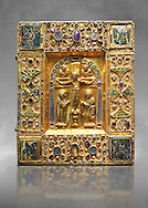"""Medieval gilded manuscript cover depicting the Crucifixion. 11th century from the treasury of the Cathedral of Maastricht. AD.  <br /> This gilded with relief panel with inlaid stones was originally a manuscript cover. Since 1677, it contained the 'documents of the oath of the Dukes of Brabant'. The back of the panel is covered with precious fabrics. On the front, in the central part, is depicted a crucifixion the style of which is reminiscent of the works of the goldsmiths of the Emperor Henry II. On the borders are small icons and emblems including those of the Carolingians. The main interest of this work lies in the four enamelled on gold symbols of the evangelists in the four corners, two being 'Enforced' on a background of gold, the others being painted.<br /> <br /> One of Latin inscriptions states that 'Beatrice  ordered the execution ( of this work) in honour of Almighty God and his saints"""". It could be Beatrice wife of Hermann II of Swabia and daughter Emperor's sister-Conrad II or, more likely, Beatrice of Tuscany who in 1036 was wife of Boniface III, Marquis of Tuscany, and second wife of Geoffrey the Bearded, Duke of Lower Lorraine and Brabant.<br />  The Louvre Museum, Paris. .<br /> <br /> If you prefer you can also buy from our ALAMY PHOTO LIBRARY  Collection visit : https://www.alamy.com/portfolio/paul-williams-funkystock/romanesque-art-antiquities.html . Type -   Louvre   - into the LOWER SEARCH WITHIN GALLERY box. Refine search by adding background colour, place, museum etc<br /> <br />  Visit our MEDIEVAL PHOTO COLLECTIONS for more   photos  to download or buy as prints https://funkystock.photoshelter.com/gallery-collection/Medieval-Romanesque-Art-Antiquities-Historic-Sites-Pictures-Images-of/C0000uYGQT94tY_Y"""