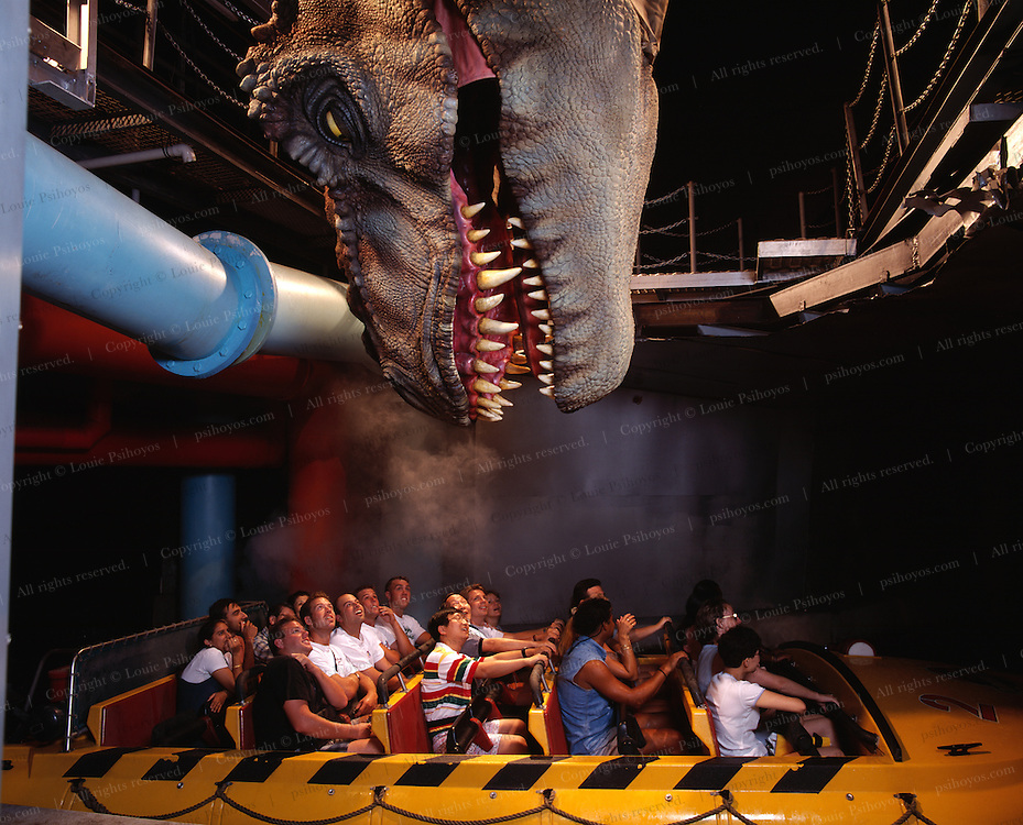 """Famous Jurassic Park Ride at Universal Studio's Amusement Park in Southern California.  Jurassic Park was one of the largest grossing movies ever made, directed by Steven Spielberg.<br /> Famous Jurassic Park Ride at Universal Studio's Amusement Park in Southern California.  Jurassic Park was one of the largest grossing movies ever made, directed by Steven Spielberg.<br /> <br /> <br /> T. Rex, """"tyrant lizard king,"""" was one of the largest-ever meat eating land animals.  The bi-pedal giant grew to some 40 feet (12 meters) and weighed up to 7 US tons (6.5 metric tons) and small two-fingered hands that were actually surprisingly strong."""