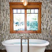Sleek and modern bathroom design with tile and bathtub