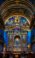 """""""Madonna Illuminates the high altar of Santa Maria Sopra Minerva Assisi""""…<br /> <br /> Santa Maria Sopra Minerva is the church dedicated to Mary which was built over a Roman temple to Minerva, the goddess of wisdom. Parts of the Roman temple which dates from the time of Augustus (63 BC-AD 14) remain. As Christianity became official in the Roman Empire, the Temple became abandoned. Benedictine monks restored the temple and eventually, the Italian Renaissance-inspired a newfound appreciation for classical art and architecture. In 1539, Pope Paolo III ordered the Temple of Minerva to be completely restored and dedicated to the Virgin Mary, queen of true wisdom. The temple then took the name of Santa Maria Sopra Minerva. The six imposing Corinthian columns and the entire Roman façade are still intact after 2,000 years along with the towering Campanile. As the center of ancient Assisi, and still prominent today… this former Temple and now sacred church seems to be at the heart of the existence of Assisi. Additionally, the famous artist Giotto painted frescos of the life of Saint Francis which adorn the walls of the Saint's Basilica including images of Santa Maria Sopra Minerva. Ironically, Giotto's placing of St. Francis in the local scenery was the first of its kind, thus the beginning of the Renaissance. In 1791 it was consecrated on the Solemnity of the Assumption of Our Lady. And, after the Apparition of Our Lady as the Immaculate Conception seen by St. Bernadette which took place in Lourdes, France…this statue of the Virgin Mary was erected in the hollowed earth behind the altar. As I hiked the steep grade upward to the top of Assisi, a respite seemed to arise from the ancient Roman era and took me back in time. The imposing columns gave way from the ancient exterior progressing inside discovering the serene and peaceful Virgin Mary, Queen of True Wisdom."""