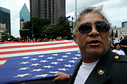 """David Gutierrez who served in the American military  describes how """"hispanics need to earn their place in American society, they must participate and follow the rules of the country"""" during theMegaMarch for Immigration Reform, in Dallas Texas  May 01, 2010"""