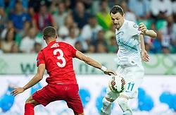 Kieran Gibbs of England vs Milivoje Novakovic of Slovenia during the EURO 2016 Qualifier Group E match between Slovenia and England at SRC Stozice on June 14, 2015 in Ljubljana, Slovenia. Photo by Vid Ponikvar / Sportida