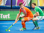 The Netherlands Sander De Wijn is watched by Michael Darling of Ireland. Ireland v The Netherlands - Semi-Final Unibet EuroHockey Championships, Lee Valley Hockey & Tennis Centre, London, UK on 27 August 2015. Photo: Simon Parker