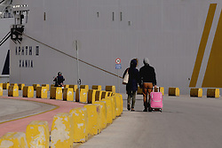 A couple walk in front of a docked passenger ferry amid a 48h strike at Piraeus port near Athens, Greece on Monday December 5, 2016. Seamen and maritime workers marched to the Shipping Ministry protesting planned reforms in taxation and social insurance system. Photo by Panayotis Tzamaros/ABACAPRESS.COM