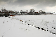The Meads floodplains after heavy overnight snowfall in January 2010, with Durleigh Brook in the foreground and the Rhode Lane housing estate in the background.