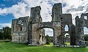 The picturesque Easby Abbey (Abbey of St Agatha) was founded in 1152, but was suppressed by King Henry VIII in 1536-7 and fell into ruin. This Premonstratensian abbey was home to canons (ordained priests), rather than monks. The still-active parish church displays wall paintings dating from the 1200s. Visit Easby Abbey on the River Swale, on the outskirts of Richmond, North Yorkshire county, England, United Kingdom. England Coast to Coast hike day 9 of 14. Overnight at Kings Head Hotel in Richmond. [This image, commissioned by Wilderness Travel, is not available to any other agency providing group travel in the UK, but may otherwise be licensable from Tom Dempsey – please inquire at PhotoSeek.com.] This image was stitched from multiple overlapping photos.