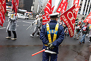 Police control union activists marching at  a demo rally organized by Doro Chiba labour union to protest the outsourcing of what they consider essential safety and repair work and fight against rationalization of JR's business. They also protested for the reinstatement of 1,047 national railway workers who lost their jobs in 1987. Shinjuku, Tokyo, Japan Saturday, February 13th 2010