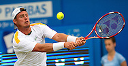 Australia's Lleyton Hewitt  returns to Croatia's Martin Cilic, during their semifinal match for the Aegon Championships at the Queen's Club in London, Britain, 15 June 2013. The play was suspended due to rain for the second time in set one, with Martin Cilic wining the first two games. EPA/BOGDAN MARAN
