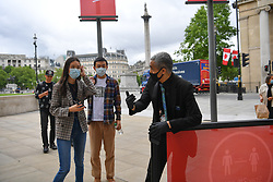 © Licensed to London News Pictures. 08/07/2020. Trafalgar Square, London, UK.. Members of the public enter the National Gallery as it reopens after a closure of 111 days. Visitors are allowed into the gallery at controlled intervals having booked time slots online as the institution applies social distancing during the coronavirus outbreak. Photo credit: Guilhem Baker/LNP.