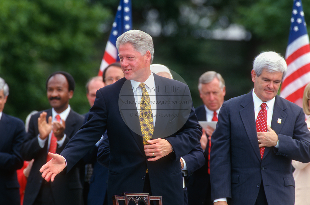 WASHINGTON, DC, USA - 1997/08/05: U.S. President Bill Clinton reaches out to shake hands after signing the balanced budget bill into law in a ceremony on the South Lawn of the White House August 5, 1997 in Washington, DC. Speaker of the House Newt Gingrich is on the right.  (Photo by Richard Ellis)