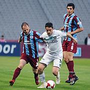 Trabzonspor's Serkan BALCI (L), Ceyhun GULSELAM (R) and Denizlispor's Okan KOC (C) during their Turkish superleague soccer match Trabzonspor between Denizlispor at the Avni Aker Stadium in Trabzon Turkey on Monday, 10 May 2010. Photo by TURKPIX