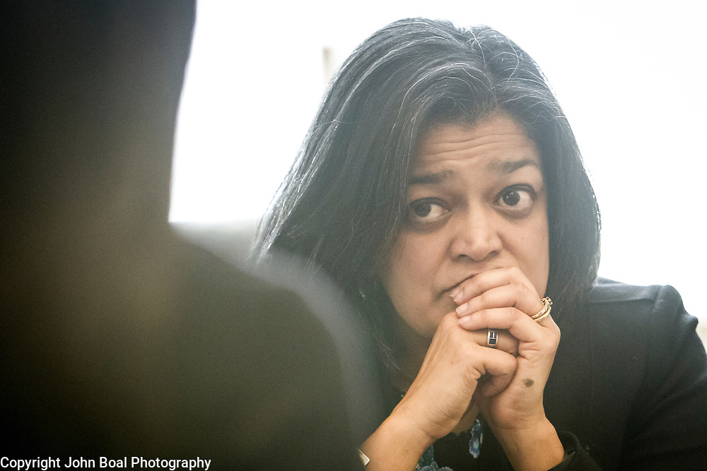Representative Pramila Jayapal (D-WA, 7) eats lunch at her desk, while meeting with her Deputy chief of Staff, Ven Neralla and Legislative Assistant, Jennifer Chan, on Tuesday, January 31, 2017.  John Boal photo/for The Stranger