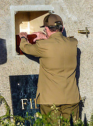December 4, 2016 - Santiago, CUBA - Cuba's President Raul Castro places the ashes of his older brother Fidel Castro into a niche in his tomb, a simple, grey, round stone about 15 feet high at the Santa Ifigenia cemetery in Santiago, Cuba, Sunday December 4, 2016.  The niche was then covered by a plaque bearing the single name,''Fidel.'' MARCELINO VAZQUEZ HERNANDEZ/POOL/ (Credit Image: © Prensa Internacional via ZUMA Wire)