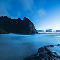 Summer night twilight and incoming tide at Kvalvika beach, Lofoten Islands, Norway