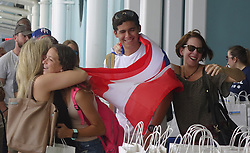 October 3, 2017 - Miami, FL, USA - Families of Caribbean hurricane evacuees who arrived on board the Royal Caribbean Adventure of the Seas, rush to greet their relatives, Tuesday, Oct. 3, 2017, at Port Everglades in Fort Lauderdale. More than 3,000 people from Puerto Rico and the U.S. Virgin Islands were brought to Florida on board the cruise ship. (Credit Image: © Joe Cavaretta/TNS via ZUMA Wire)