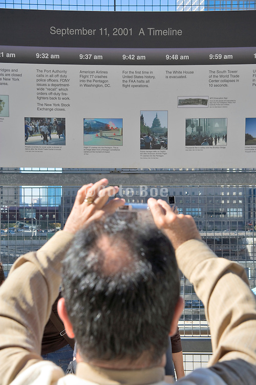 At the former World Trade Center a sign with the timeline of the happening of September 11 2001