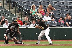 06 July 2013:  Mark Winters makes the calls behind catcher Mirabal and batter and Mike Mobbs bats during a Frontier League Baseball game between the Gateway Grizzlies and the Normal CornBelters at Corn Crib Stadium on the campus of Heartland Community College in Normal Illinois