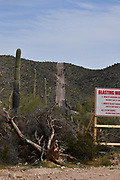 Construction of a metal border wall in Organ Pipe Cactus National Monument, Sonoran Desert, in Lukeville, Arizona, USA, separates the USA from Sonoyta, Sonora, Mexico.