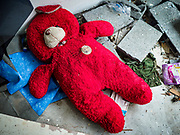 18 JULY 2017 - BANGKOK, THAILAND: A red child's teddy bear in an abandoned home on Soi 27 off of Sathu Pradit in Bangkok. The area  was a working class neighborhood of two storey shophouses. Most of the homes in the were occupied by Thais of Chinese heritage. The owner of the land sold the land to a developer who plans to build a condominium tower on the site. The residents left in early July and the shophouses will be torn down in coming weeks.       PHOTO BY JACK KURTZ