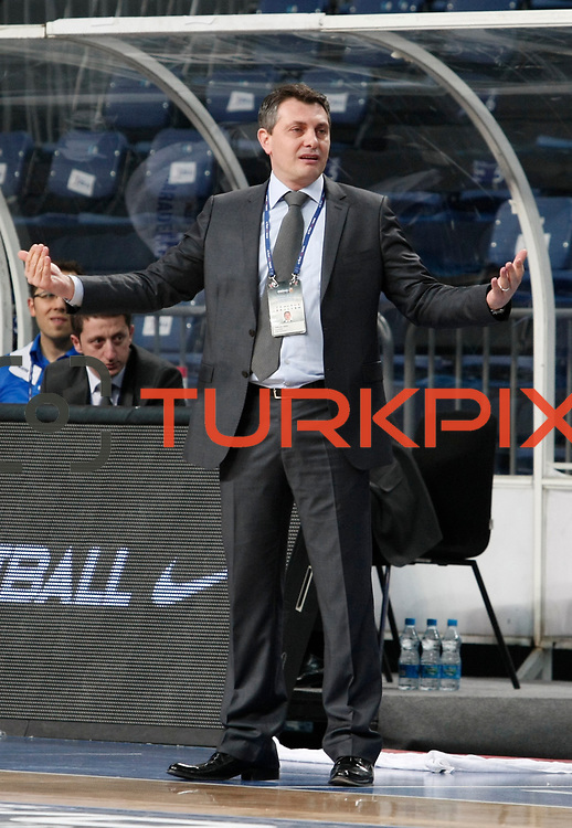 Turk Telekom's coach Timucin Meric during their Turkish Basketball League match Anadolu Efes between Turk Telekom at Arena in Istanbul, Turkey, Wednesday, January 04, 2012. Photo by TURKPIX