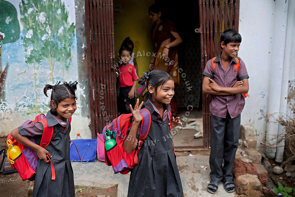 Poonam, 9, (left) her sister Jyoti, 10, (centre) and their brother Ravi, 11, (right) are about to start their very first day in a cozy, private school located by their newly built home in Oriya Basti, one of the water-contaminated colonies in Bhopal, central India, near the abandoned Union Carbide (now DOW Chemical) industrial complex, site of the infamous '1984 Gas Disaster'.