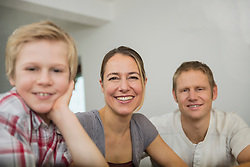Parents and son at home