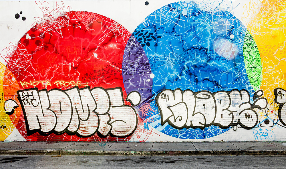 Graffiti layered over a more fine art style mural in Miami's constantly evolving Wynwood arts district