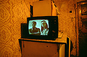 Jarovnice/Slovak Republic, Slovakia, SVK, 06.08.2003: Television inside a house in JAROVNICE the biggest Roma Settlement in eastern Slovakia. On the screen WINNETOU and OLD SHATTERHAND during a KARL MAY movie.
