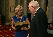While Vice President Cheney watches, Jill Biden lugs the Biden family Bible into position for the mock swearing in ceremony. Joe Biden and Vice President Dick  Cheney are posing for photographs at a mock swearing in photo session of U.S. Senators in the Old Senate Chambers of the U.S. Capitol in Washington, DC on January , 2009.  Vice President Elect Biden was sworn in as a Senator for the Senate election that he won in Delaware.  He will resign he Senate seat before the Inauguration. Photograph: Dennis Brack