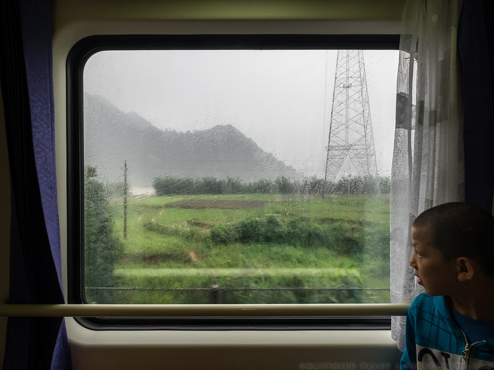 Window view across China, from the train from Guangzhou/Shenzhen to Xinjiang.