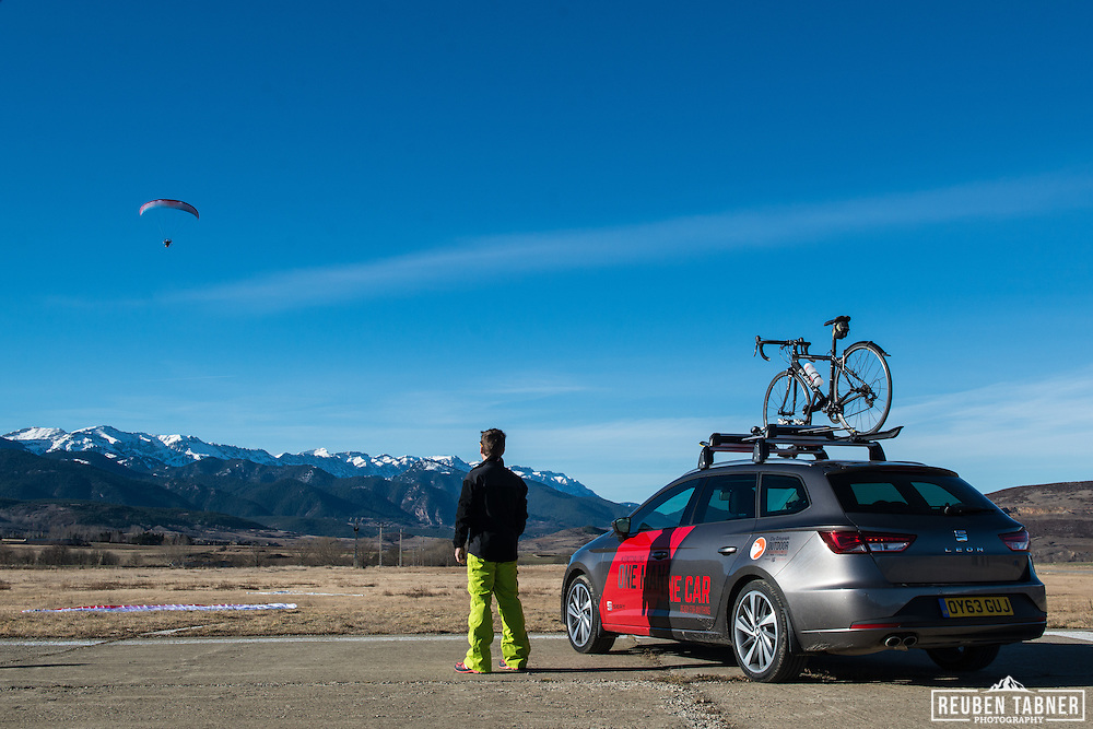 26.01.14 Tobias Mews watches a Para-Motor decend next to his new Seat Leon ST under a clear blue sky in Spain.