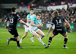 Connacht's Eoin Griffin under pressure from Ospreys' Kieron Fonotia<br /> <br /> Photographer Simon King/Replay Images<br /> <br /> Guinness PRO14 Round 19 - Ospreys v Connacht - Friday 6th April 2018 - Liberty Stadium - Swansea<br /> <br /> World Copyright © Replay Images . All rights reserved. info@replayimages.co.uk - http://replayimages.co.uk