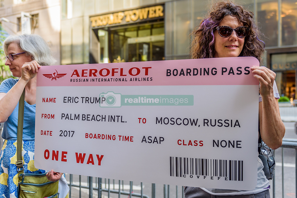 June 14, 2017 - New York, New York, United States - On Donald J. Trump's 71st birthday, June 14, 2017; Rise and Resist presented him plane tickets back to Russia. Hundreds of New Yorkers gathered outside Trump Tower for a #SadBirthday party, celebrating the ongoing resistance to his presidency and to stand against Trump's lies, hate, and corruption. (Credit Image: © Erik Mcgregor/Pacific Press via ZUMA Wire)