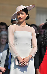 The Duchess of Sussex during a garden party at Buckingham Palace in London which she is attending as her first royal engagement after being married.