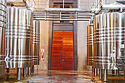 Two huge wooden doors leading to the winery vat hall Bodega NQN Winery, Vinedos de la Patagonia, Neuquen, Patagonia, Argentina, South America